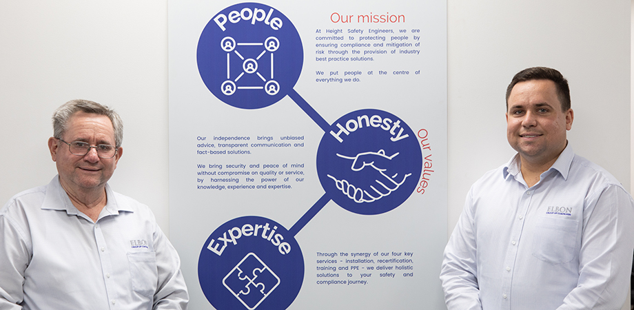 Phil (left) and Alister Noble introduce HSE's company values poster.