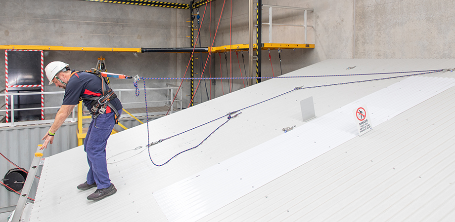 Using a roof anchor fall protection system
